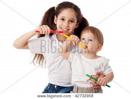 Girl teaches boy brushing teeth