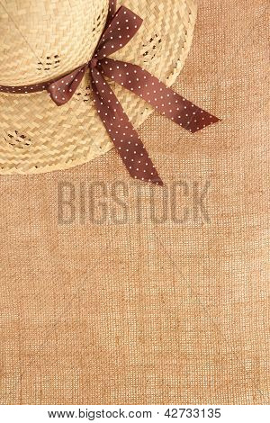 Rural Like Background With Straw Hat And Burlap