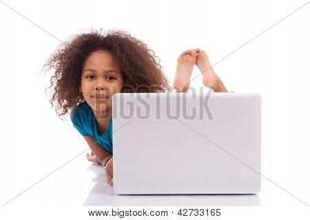 Little African Asian Girl Using A Laptop