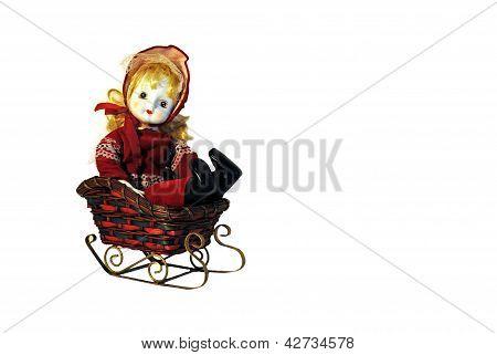 porcelain doll rides sled