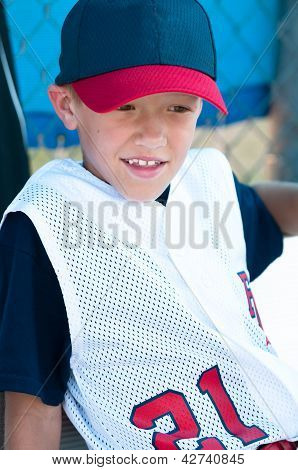 Little League Baseball Player In Dugout