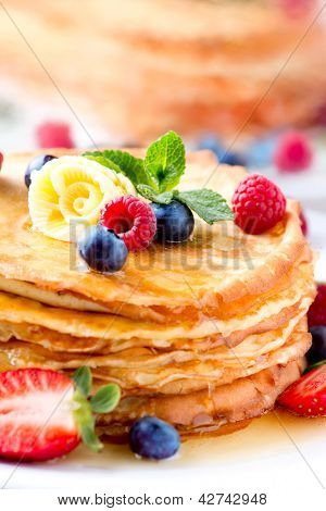 Pancake. Crepes With Berries. Pancakes stack with Strawberry, Raspberry, Blueberry, Butter and Syrup