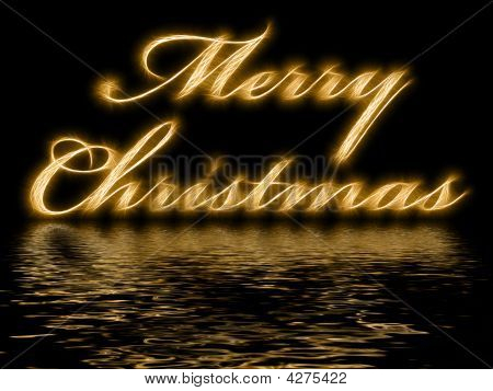 Merry Christmas Written With Reflection In Rippled Water