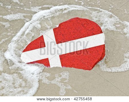Flag Of Denmark On A Stone On The Beach