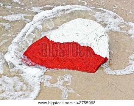 Flag Of Poland On A Stone On The Beach
