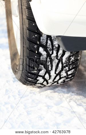 Car wheel on a white snow