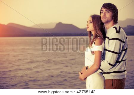 Portrait of a young people in love looking dreamily into the distance.