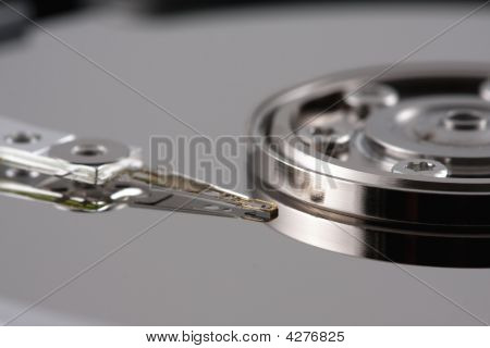 Close-up Of A Hard Drive Needle With Reflection Side View