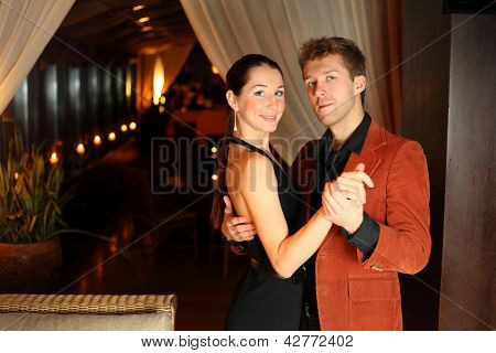 woman and a man dancing in the restaurant