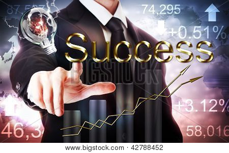 Businessman Pointing To Success With Rising Graph And Light Bulb