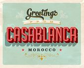 Vintage Touristic Greeting Card -Casablanca, Morocco - Vector EPS10. Grunge effects can be easily re