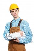 young builder worker in protective hardhat and workwear overall with drafts plans isolated