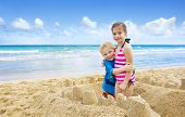 foto of shoreline  - Children building Sandcastles on the Beach - JPG