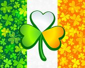 picture of triskele  - Irish flag background made from green and orange clovers with big clover on it - JPG