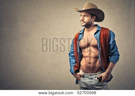 handsome cowboy with hat and open shirt