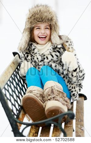 Winter, snow, winter fashion girl - happy young girl playing in winter park
