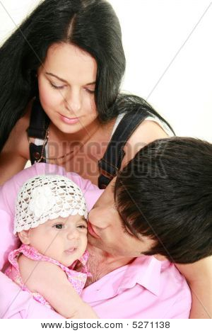 Happy Family With Newborn Daughter Over White