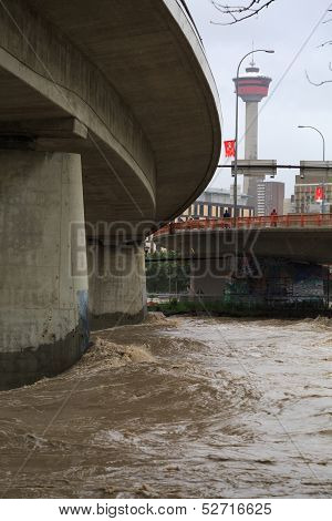 The Overflowing Bow River Rips Past The Ctrain Bridge