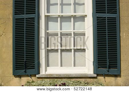 Window And Shutters To English House