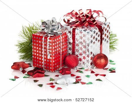 Two gift boxes and christmas decor. Isolated on white background