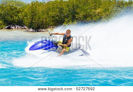Man on Jet Ski having fun in Ocean