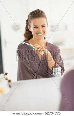 Portrait Of Smiling Young Woman With Toothbrush
