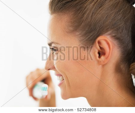Smiling Young Woman Holding Toothbrush With Toothpaste