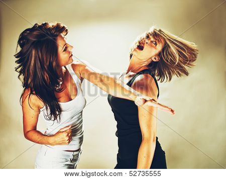 a woman hitting another woman vintage toned
