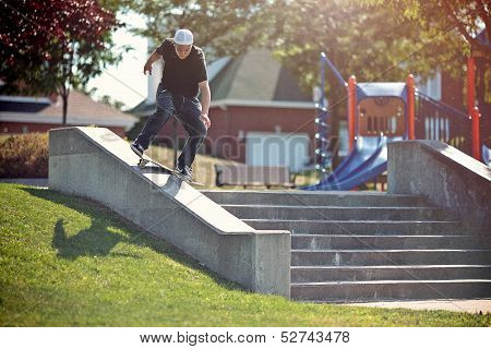 Skateboarder Doing A Frontside Lipslide Trick In A Park