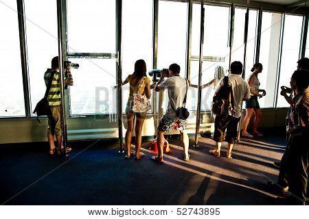 People Enjoying View Across Bangkok Skyline