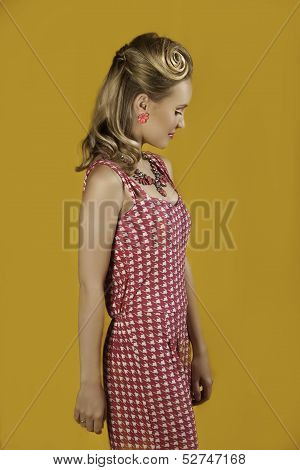 Beautiful  blonde retro pin-up girl in pink