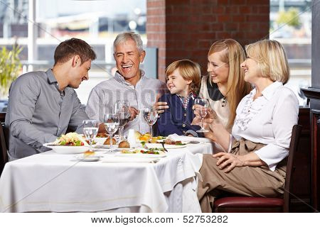 Happy family with child smiling together in a restaurant