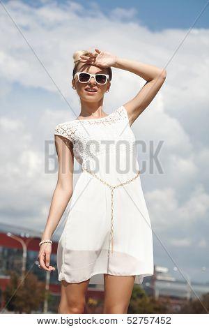 Young Pretty Woman Enjoying The Sun