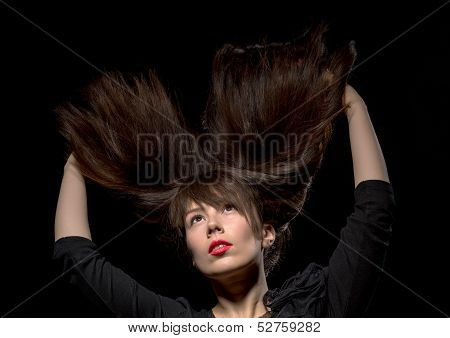 Young Woman With Her Hair Flying In The Air