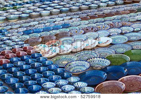 Rows of cups on a street market in the city of Bukhara, Uzbekistan
