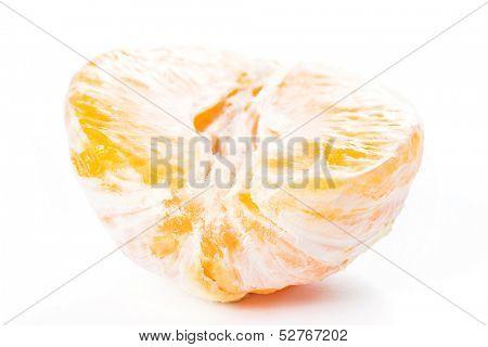 Tasty peeled orange over a white backgroudn