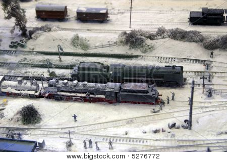 Model of steam locomotives on railway depot in winter