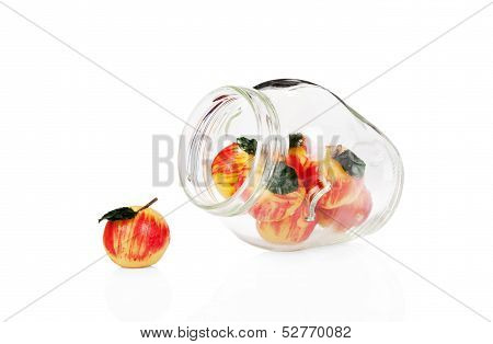 Marzipan Apples In A Glass Jar Isolated On White Background