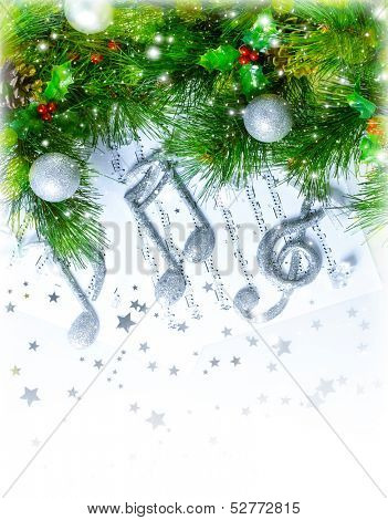 Image of Christmas treble clef on notes pages, beautiful melody, silver ornament on green fir tree border, traditional Christmas carol, New Year greeting card, musical sheet, Xmas decoration