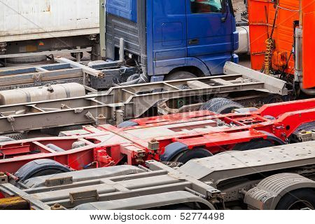 Abstract Automotive Transportation Background With Empty Trucks Cargo Trailers