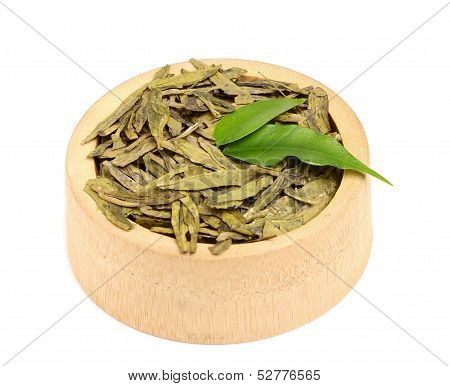 Dried Green Tea Leaves In A Wooden Bowl.