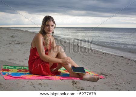 Beautiful Girl Taking A Rest When Reading At The Beach