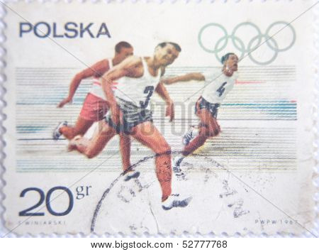 POLSKA - CIRCA 1967: stamp printed by Poland shows sprinters running on Olympic Games