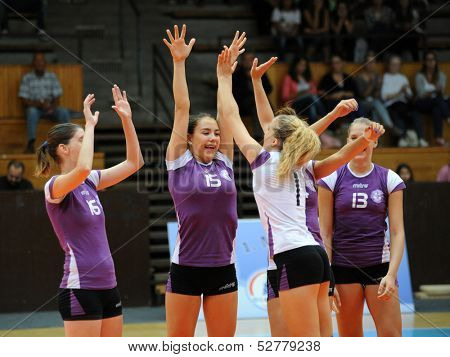 KAPOSVAR, HUNGARY - SEPTEMBER 20: Ujpest players celebrate at the Hungarian I. League volleyball game Kaposvar (white) vs Ujpest (purple), September 20, 2013 in Kaposvar, Hungary.