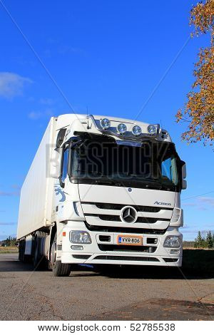 White Mercedes-benz Actros Truck On A Clear Autumn Day