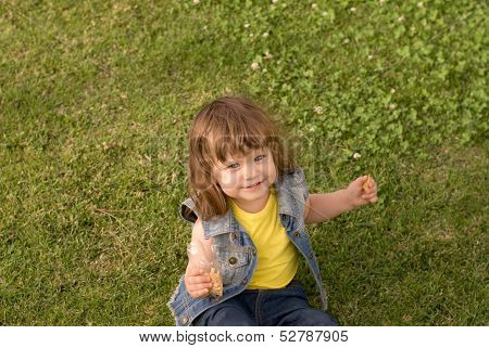 The Little Girl  Is Playing On The Meadow