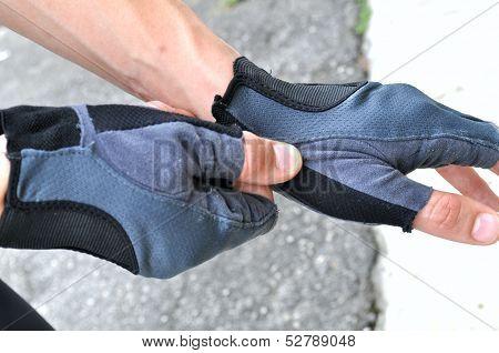 wearing sports gloves