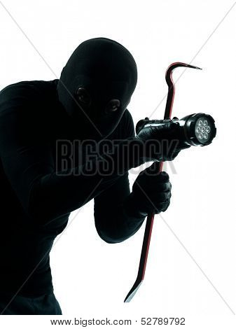 thief criminal burglar portrait masked  in silhouette studio isolated on white background