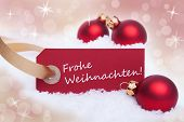 pic of weihnachten  - A Red Label With the German Words Frohe Weihnachten Which Means Merry Christmas - JPG