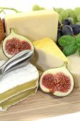 stock photo of grated radish  - Selection of cheese with knife and fig - JPG